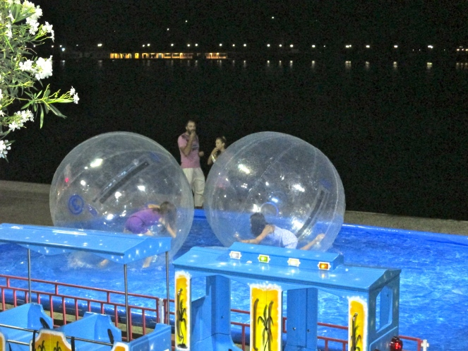 Bubble fight on the pier overlooking the Aegean Sea